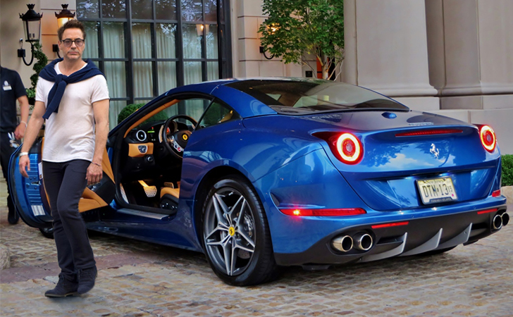 Rdj Has Almost As Many Cars Tony Stark His Collection Is Pretty Vast Though He S Most Commonly Seen In Navy Blue Ferrari